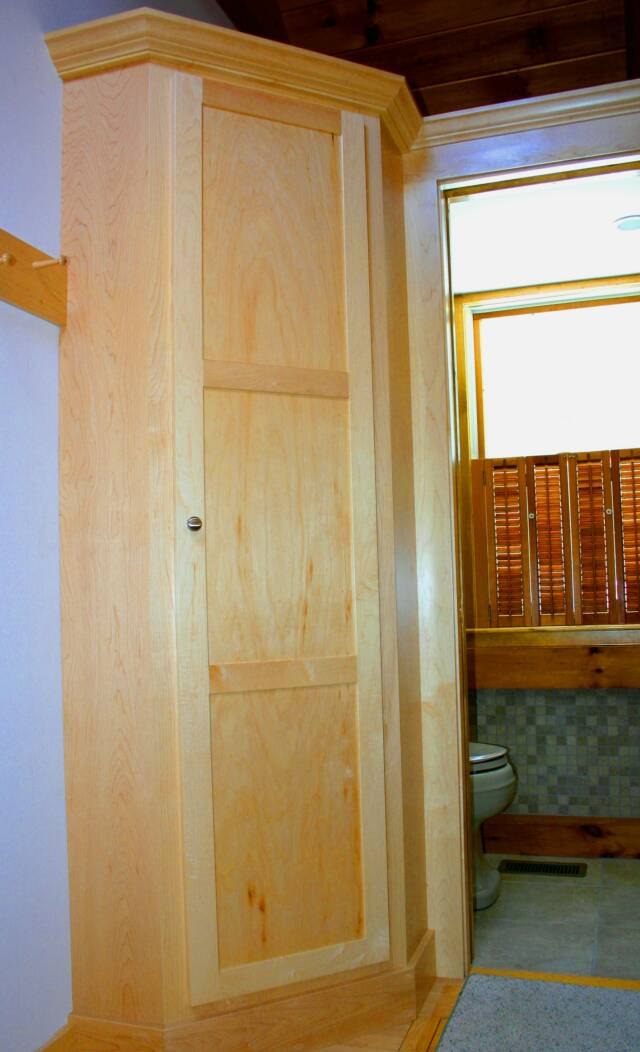 Maple broom closet and storage cabinets
